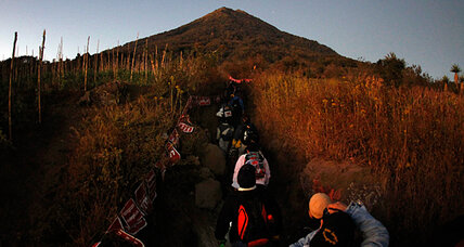 Guatemalans scale volcano to protest domestic violence