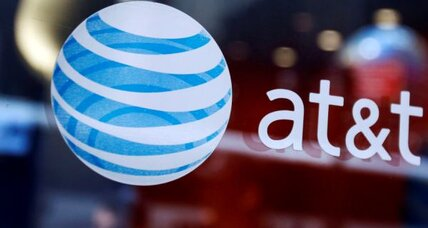 AT&T posts huge loss on charges, iPhone subsidy