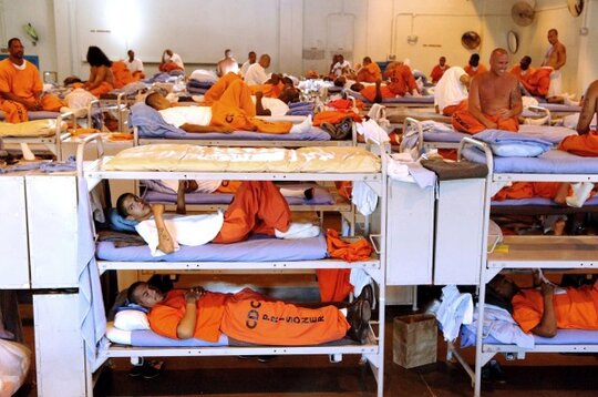 four ways to relieve overcrowded prisons revamp habitual  in this undated file photo released by the california department of corrections inmates sit in crowded conditions at california state prison los angeles