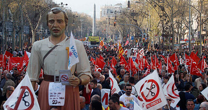 Spain leader vows hard line as hundreds of thousands protest austerity