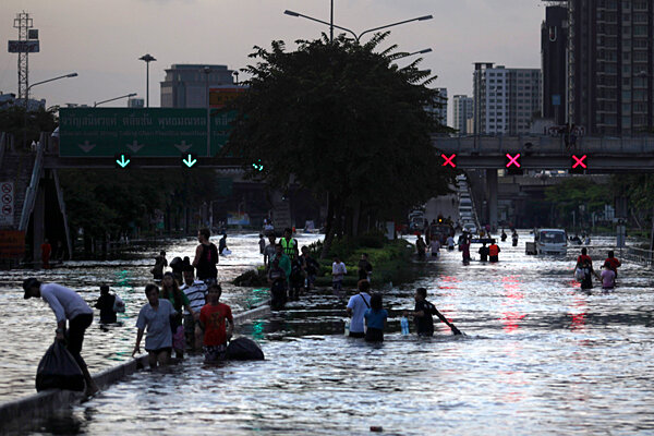Thailands blueprint to rein in fallout from floods and drought thai residents wade through floodwaters in bangkok thailand in this october 2011 file photo malvernweather Image collections