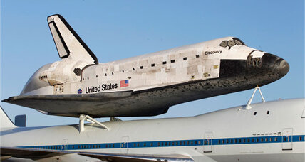 Space Shuttle Discovery mounted on 747 for ride to Smithsonian