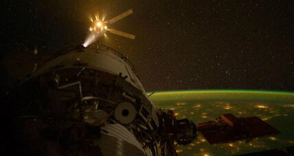 Amazing photo: Cargo vehicle docks with space station over Earth's city lights (+video)