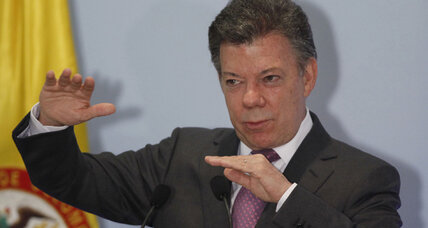 Santos hailed as regional leader, but approval falls at home in Colombia