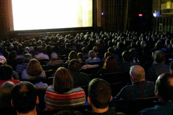 noisy kid at movie theater hit by washington man watching