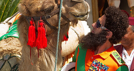 'The Dictator' rides into Cannes on a camel