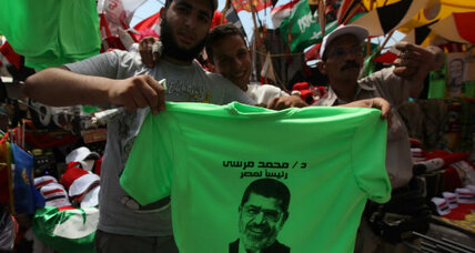 As showdown with military looms, Egypt liberals back Muslim Brotherhood