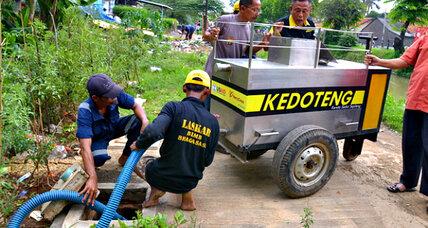 Three-wheeled carts, better septic tanks help clean up Jakarta