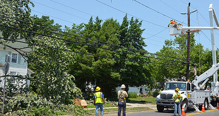 Mid-Atlantic residents, still without power, don headlamps, skirt fallen trees