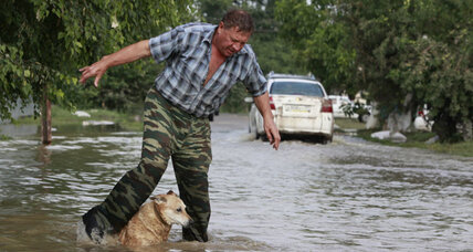 Russian floods kill 150 after a foot of rain falls in a day