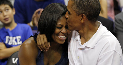 Obama takes in Olympic basketball, appears on stadium 'Kiss Cam'