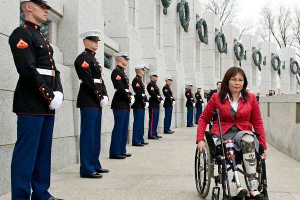 Asian americans take higher profile in congressional races tammy duckworth then assistant secretary of the us department of veterans affairs arrives at the world war ii memorial in washington for a ceremony sciox Gallery