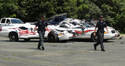 Vt. man accused of crushing 7 cop cars with tractor due in court