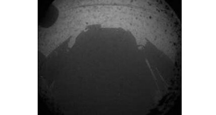 Curiosity rover beams back first photo from Martian surface