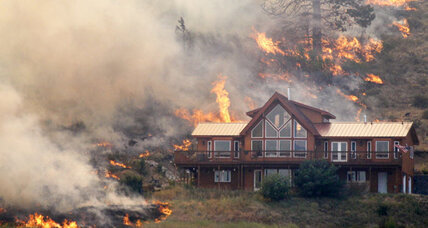 Wildfire destroys about 70 homes in rural Washington