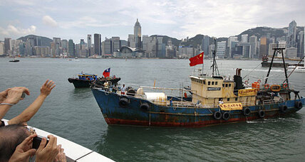 Detained Chinese activists return by boat from Japan
