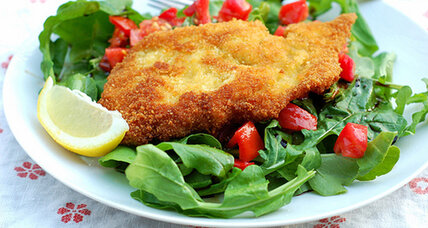 Chicken Milanese on a bed of arugula and tomatoes
