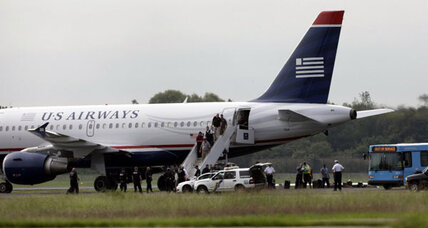 US Airways jet returns to Philadelphia after liquid explosives tip