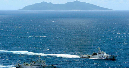 China reacts with surveillance ships to Japan's purchase of disputed islands