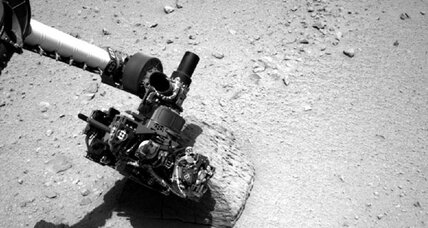 Mars Curiosity rover touches rock, 'does a science'