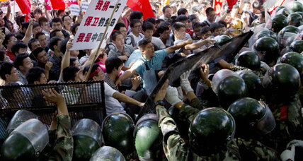 Chinese protesters clash with police outside Japanese embassy