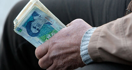 Iran's president blames currency nosedive on 'psychological pressures'