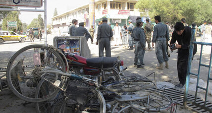 Another insider? Uniformed Afghan suicide bomber kills 14