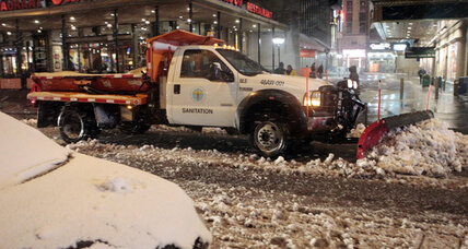 Wet snow and power outages hit recovering East Coast