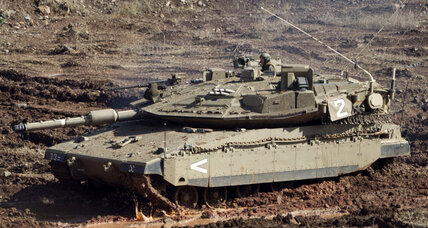 Israeli tanks hit inside Syria, but Israel not eager to enter conflict