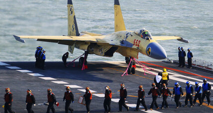 In show of power, China lands first jet on aircraft carrier