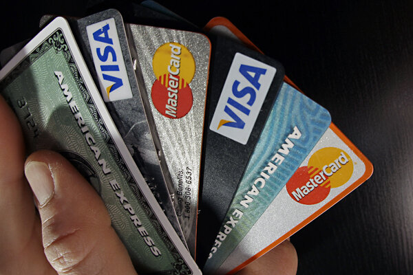 Eight surprising ways to raise your credit score csmonitor in this march 2012 file photo consumer credit cards are posed in north andover mass as long as you pay down your balances asking for a higher line of reheart Choice Image