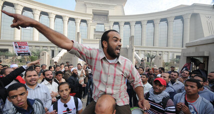 Blocked by Islamist crowds, Egypt's top court suspends work
