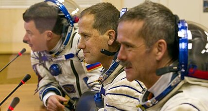 Russian trio heads for space station