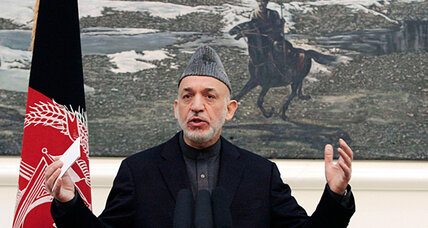 Back in Afghanistan, Karzai shifts tone on US troop immunity
