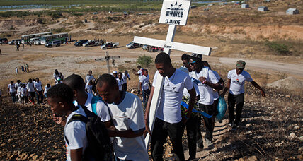 Haitians heap the nation's burdens on a half-ton cross