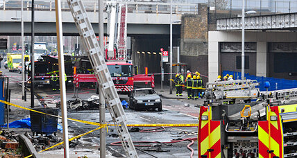 Helicopter crashes into construction crane in London, killing two