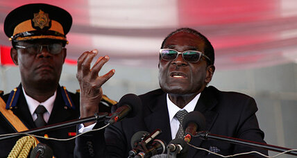 Is Nelson Mandela too soft on white South Africans? Robert Mugabe says so.
