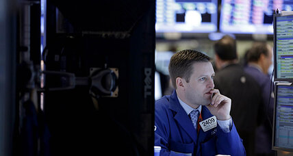 Stocks slip lower; Dow logs strong start to year