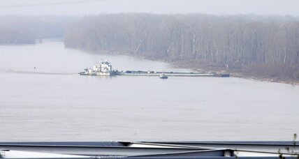2 barges damaged in bridge crash, oil spill