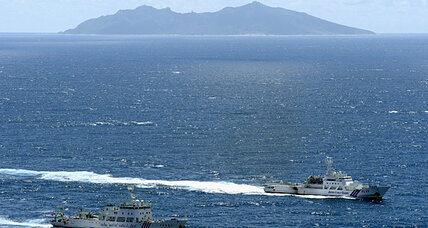 Japan boosts defense as some in China and Taiwan agree on disputed islets