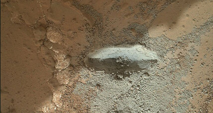 NASA's Curiosity rover taps Martian rock with its drill
