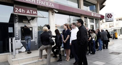 Ahead of critical deadline, Cypriots hit the ATMs and lash out at Germany