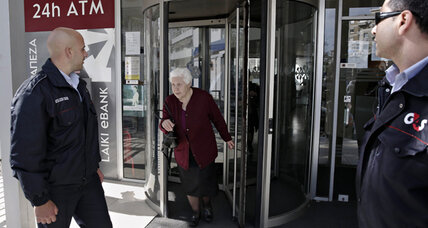 Cypriot banks reopen their doors to an angry, but orderly, clientele