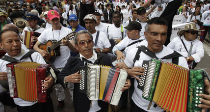 Tens of thousands march for peace in Colombia after decades of conflict