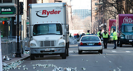 Boston Marathon bombing: Feds raid apartment, police seek rental van (+video)