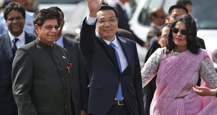 In first trip abroad, Chinese premier visits India