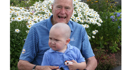 George H.W. Bush shaves head in solidarity with sick child