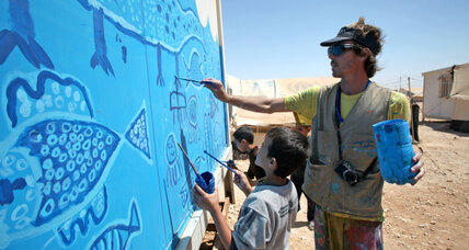 US artist, Syrian children beautify a refugee camp