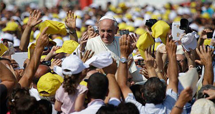 Pope Francis greets immigrants, blasts indifference over migration deaths