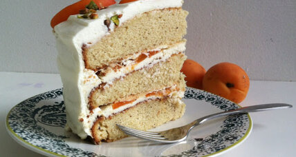 Pistachio apricot cake with mascarpone filling and whipped cream frosting